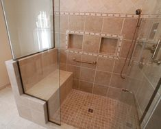 """Need a bench, storage space inside shower?"" ""shower tile detail; two types tile in shower;"" ""curbless shower for access, shower wand , and bench"""