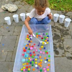 POM POM SCOOPHere is a fun and easy to set up counting activity using pom poms in water Throw a bunch in a sensory bin put an inch or two of water in it Then add a slotted spoon and ten plastic cups numbered to And the clean up is super easy Check out the blog for more easy peasy activities PLaYCReaTivEly happytoddlerplaytime elnumbers