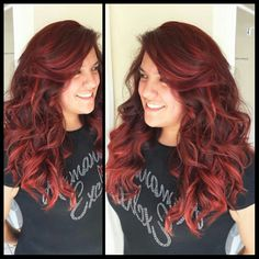 Intense red balayage ombre with a long layered haircut and styled with 1inch wand.