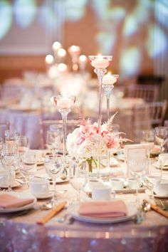 Romantic light pink place settings and candles.