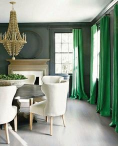 A New Set Of Green Curtains Is A Great Way To Showcase Emerald In Your Home (And The Greenery On The Table Doesn't Hurt Either)