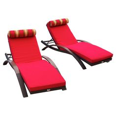 Set of two outdoor chaises with contoured designs and matching bolster pillows.    Product: Set of 2 loungersConstruc...