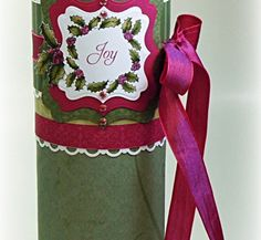 A Pringles can altered and labeled with stamp such as this one.  Perfect to stack full of Christmas cookies.