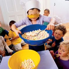 Blindfold the Cook--Give kids a large spoon, a bowl of marshmallows and a blindfold. Set timer for one minute. Use spoons to scoop marshmallows. Winner has the most marshmallows.