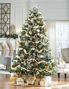 A beautiful Christmas tree. Silver Christmas Decorations, White Christmas Trees, Ribbon On Christmas Tree, Beautiful Christmas Trees, Magical Christmas, Christmas Tree Toppers, Pink Christmas, Outdoor Christmas, Xmas Tree