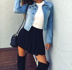 Wheretoget - Blue denim jacket, white tee-shirt, black skater skirt, black knee-high boots, and black shoulder bag