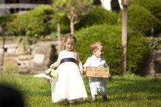 adorable flower girl and ring bearer with a sign!