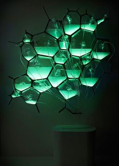 Bio-Light by Philips is a concept design and consists of hand-blown glass cells containing bioluminescent bacteria and their food source, by SpicySugar