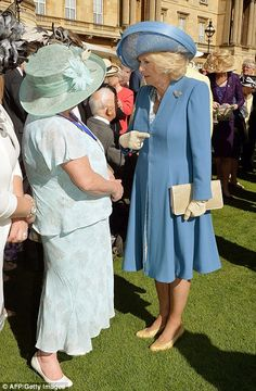 Camilla, Duchess of Cornwall speaks with attendees at the first Garden Party of the season, 12 May 2015.