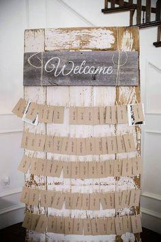 Escort cards on antique door. Welcome sign. Rustic Wedding Chic
