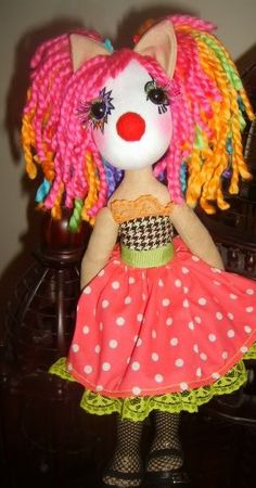 I'm not normally a clown fan, but she is adorable.  Malibukasey on craftster made her.