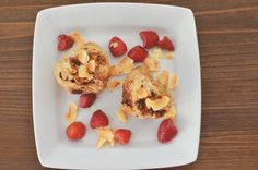 Heart shaped whole wheat cinnamon buns with strawberries and coconut. Perfect for Valentine's Day!