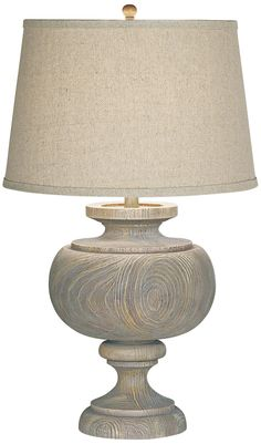 Upgrade any room's décor with this Pacific Coast Lighting Kathy Ireland Grand Maison Table Lamp. This large table lamp's graceful curves and weathered woodland finish create a soft, serene atmosphere. The beige linen shade tops it off perfectly. Large Table Lamps, Grey Table Lamps, Table Lamp Wood, Coastal Bedrooms, Coastal Living Rooms, Coastal Curtains, Coastal Bedding, Living Spaces, Coastal Style