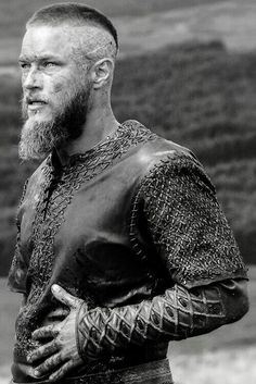 VIKINGS From the look, this may be Ragnar after the spear slices his belly open. I'm going to stay with that story because it means he lives. Of course he lives, Vikings, the show, wouldn't be the same without him. Vikings Tv Show, Vikings Tv Series, Ragnar Lothbrok Vikings, Ragnar Lothbrok Haircut, Travis Fimmel, Wallpaper Vikings, Bracelet Viking, Viking Series, History Channel
