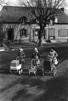 By Edouard Boubat, These girls win the prize... no crowd here... just a perfect day to take their dollies out for an outing.  AAAaaah!