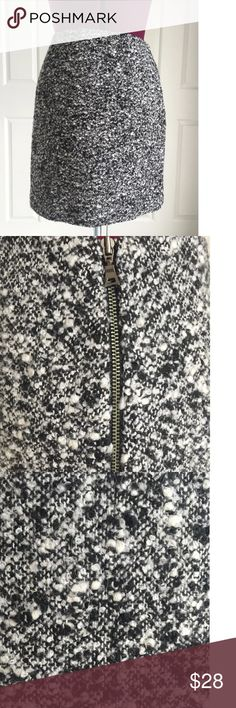 Tahari Wool Blend Boucle Lined Mini Skirt Black White Boucle Mini Skirt  Exposed Side Zip  Lined  Waist 28 and Length 17  Shell 70% Polyester and 30% Wool  Lining 98% Polyester and 2% Elastane  Dry Clean  Please let me know if you have any questions.  Thank you for looking!!!!!!! Tahari Skirts Mini