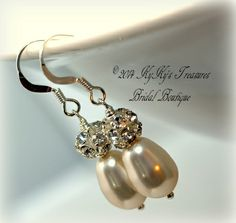 These gorgeous earrings feature your choice of white, cream or creamrose Swarovski pear shaped pearls topped with a 6mm sparkling rhinestone bead. They're strung on sterling silver ball-end head pins and dangle from sterling silver earwires. These earrings make an elegant accessory for any bride on her special day! $14.00