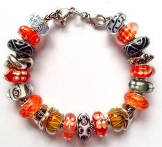 What to do with Tangerine? Black & tangerine Trollbeads bracelet design by Tartooful