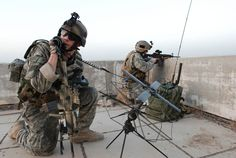 Tatical Air Control Party specialists provide over-watch of friendly forces in an undisclosed location utlizing a PSN-13 global positioning system and an AN/PRC-117F multiband manpack radio. TACPs use a variety of equipment to call in close-air support for ground forces. The TACP-Modernization program office at Hanscom AFB, Mass., is charged with equipping TACP Airmen with the necessary communication tools. (Courtesy photo)