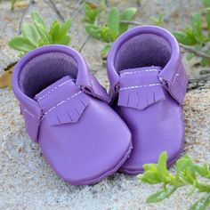 These thick, soft, leather moccasins are a gorgeous shade of purple - just like the morning glory that grows along the beach where they're made.  Made of durable, 100% genuine leather.  These soft soled shoes are perfect for helping your active toddler's tiny toes grip the ground while learning to walk.  Gone are the days of backtracking to look for your babe's lost shoe.  The elastic around the ankle helps keep these moccasins on your little one's feet.This item is hand...