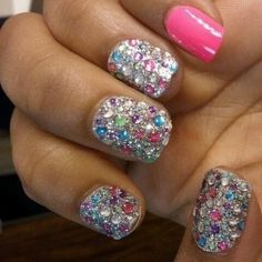 Silver with multicolored jewels & one pink nail