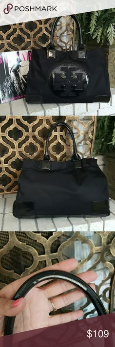 Tory Burch Large Ella Nylon Tote Handbag I have a Tory Burch handbag.   Called the Large Ella Nylon Tote.. In black nylon with patent leather trims.. it is used.. Has some peeling on trims of handles and edges. Also has some markings on inside and a few on the outside. Authentic! Tory Burch Bags Totes