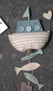 Hangings. Can add fish to bottom of boat or beach shack. Or add surf boards and flip flops to bottom of shack. Can add writing, words , sayings, verses.