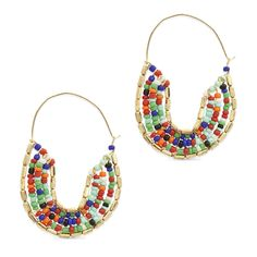 """The Kaya earrings are unique, fun and incredibly cute acessories. Make a statement about your style by sporting these seed bead hoop earrings. - Seed beads, wire - 2 1/2"""" long"""