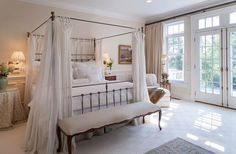 Beautiful french style bedroom with canopy bed, ottoman and french doors Bedding Master Bedroom, Master Bedroom Design, Bedroom Decor, Bedroom Ideas, Bedroom Seating, Master Room, Master Bedrooms, Bedroom Designs, Bedroom Inspiration