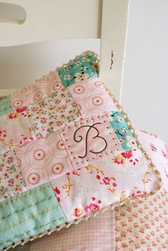 Sweet patchwork pillow - would be cute to use old baby clothes