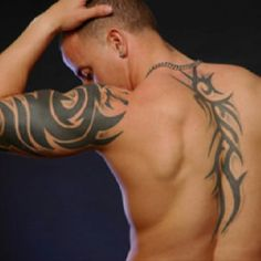 Tattoo, I was also lookin at this guys sexy back....wow