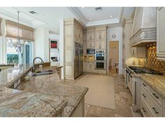 ONE OF THE MOST SPECTACULAR HOMES WITH ELEGANT DESIGN AND AMAZING VIEWS OF WATERS. A TRUE OASIS IN ISLANDS ESTATES. BEST KITCHEN DESIGN AND STATE OF ART APPLIANCES! MUST SEE!