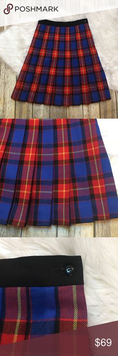 Escada Plaid Skirt 100% wool. Euro size 38. Waist measures 14 1/2 inches across, 22 1/2 inches in length. Side zip and button. Excellent preowned condition. Believe it may be a vintage piece, super fun bright colors! Escada Skirts A-Line or Full