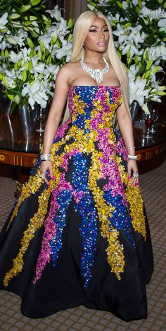Nicki Minaj stepped out during New York Fashion Week looking like a true royal in her showstopping princess gown by Oscar de la Renta heavily adorned with rainbow floral appliqué. Leave it to the singer to completely own the look with her layers of glamorous bracelets and jaw-dropping diamond necklace.