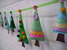 felt Christmas tree garland (or ornaments) with buttons, pom poms, and/or ribbon