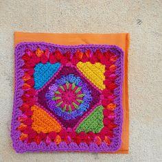 crochet granny square with fabric lining, crochet bug, crochet purse, multicolor crochet
