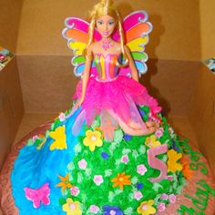 I purchased the Barbie Doll Figure, and made all of the flowers out of fondant. It is rainbow cake with buttercream icing. The waterfall was. Barbie Birthday Cake, Barbie Cake, Barbie Dolls, Blue Icing, Barbie Dream House, Buttercream Icing, Yummy Cakes, Seasonal Decor, Cupcake Cakes