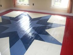 Painted floor, patterned after a quilting square my mother in law made in 1941