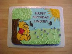 Winnie the Pooh cake with music notes. The flowers are drop flowers and sweet peas. Music notes are chocolate candy made from a mold. No tutorial, just cute picture