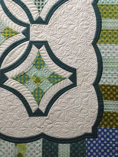 Becky Rico's version of Urban Nine-Patch with added scalloped border, a Sew Kind of Wonderful quilt, quilted by SKoW.