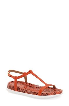 Free shipping and returns on Calvin Klein 'Doma' T-Strap Sandal (Women) at Nordstrom.com. Sleek, minimalist design and a snake-embossed footbed define this crisp T-strap sandal that's easy to pair with your wardrobe, while a cushy padded insole makes it easy to wear.