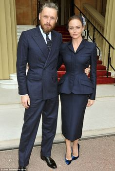 Fashion designer Stella McCartney collected her OBE from Buckingham Palace on Tuesday, wearing a Wallis Simpson style fitted skirt suit