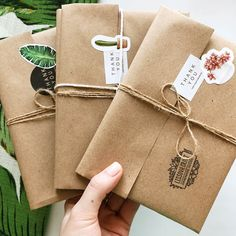 KRAFT PAPER WRAPS : can you wrap like that? with this awesome gift wrapping idea because of the brown paper that's been used as canvas for all these cute tags and stickers. they look soo gorgeous!