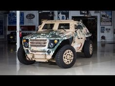 Army General Dennis L. Via and Chief Engineer Dr. Grace Bochenek give Jay a tour of the Army's latest vehicle, designed to minimize fuel consumption and maximize the safety of our troops.