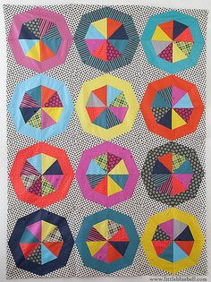 Spinning Stars......free pattern from Anna Maria Horner..love with white outer edge