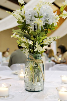 Simple centerpieces at our wedding. Vintage blue Mason Jar