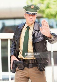 Policeman making stop gesture Cop Uniform, Men In Uniform, Navy Uniforms, Police Uniforms, Army Police, Police Officer, Security Uniforms, Police Outfit, Scruffy Men