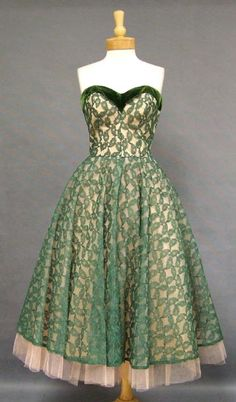 1950's cocktail dress in deep green lace over two layers of pink tulle