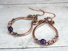 "♦ Amethyst and hammered copper wire wrapped earrings. These copper wire earrings have been wire wrapped with quality amethyst beads and copper beads then antiqued to a warm rich patina. Handmade in USA. Designed for everyday wear. Great for any occasion. Makes a great gift. Thank you for checking them out. ♦ Earrings measure 1-1/8"" long to ear wire. Earrings are 1-1/8 wide also. ♦ In stock and ready to ship. See Customer feedback: ♥ (Example) ♦ Very happy with my purchase. Great service…"