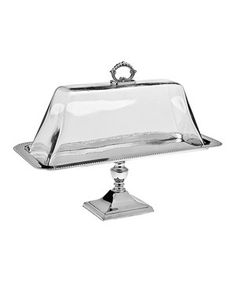 """17""""L x 10""""T x 8""""D Whether serving a handmade cheese log and crackers for the evening's appetizer or apple turnovers for dessert, this pedestal tray and accompanying glass lid are the perfect presentation pieces."""